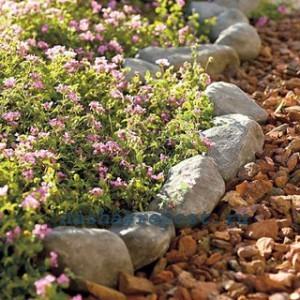 Как сделать клумбу из камней своими руками